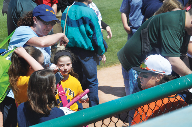Bryan Sabatella signs autographs for a group of students from Wading RIver Elementary School. (Credit: Grant Parpan)