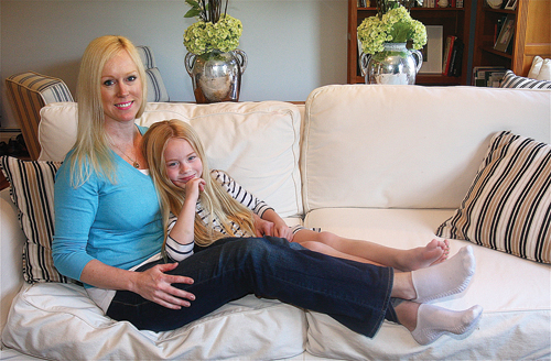 Five-year-old Claire McKenzie with her mother, Erica, at home in Laurel last month. (Credit: Barbaraellen Koch)