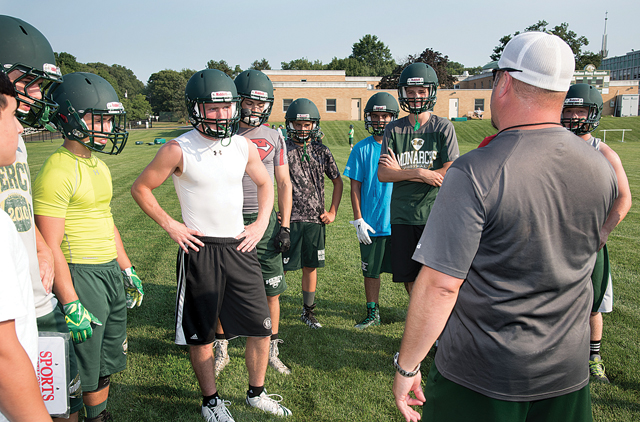 McGann-Mercy football coach Jeff Doroski goes over instructions during a recent practice. (Credit: Robert O'Rourk)