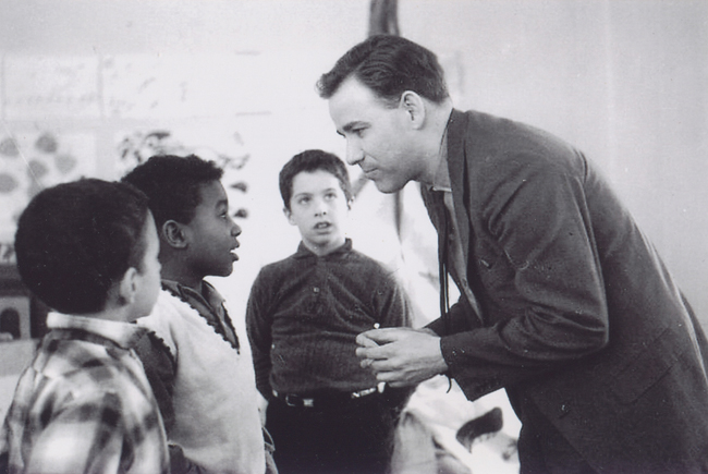 Mr. Swan converses with some young students in an undated photo. (Credit: courtesy photo)