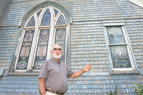 Stained-glass windows revealed at theater
