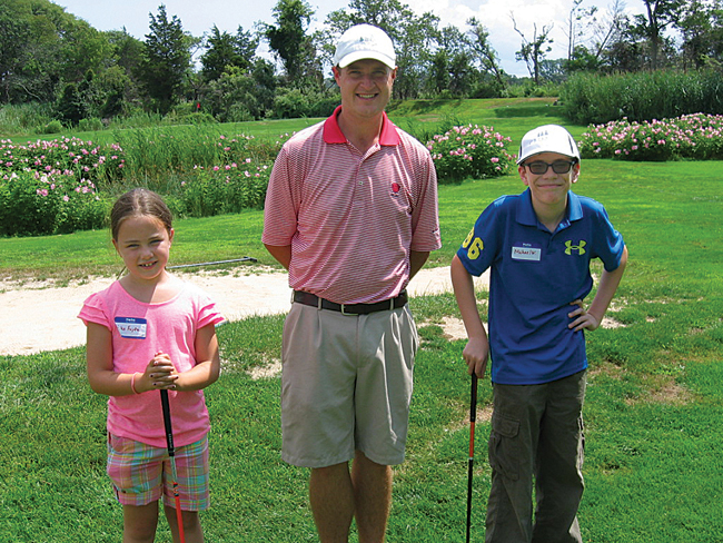 The Cedars Golf Club professional Jimmy McLaughlin with two members of the Cedars Kids Club, Aiko Fujita, left, and Michael Wineberger. (Credit: Jay Dempsey)