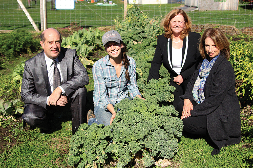 Pictured in Southold Elementary School's garden Monday (from left): Greenport and Southold schools superintendent David Gamberg; Lucy Senesac, Slow Food East End's master farmer for North Fork schools; Riverhead superintendent Nancy Carney; and Mattituck superintendent Anne Smith. (Credit: Jen Nuzzo)