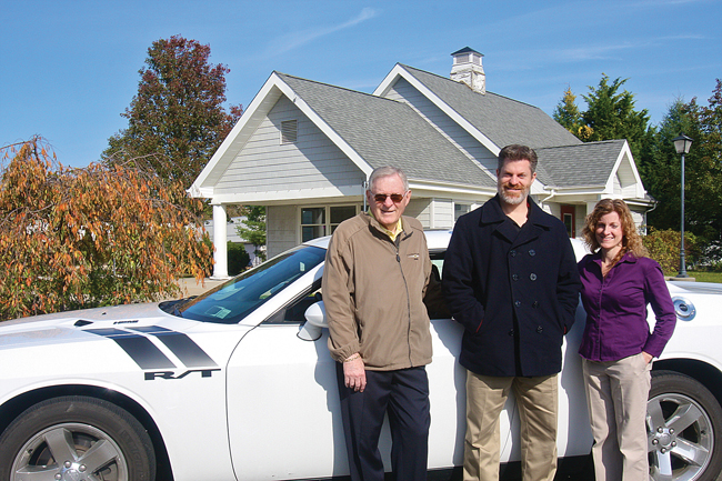 Riverhead Dodge president Tony Strollo (left) with his son T.J. Strollo, vice president, and daughter Jane Millman, secretary and treasurer, at the former Out East Family Fun site on Route 58, which they recently purchased to relocate their dealership. (Credit: Barbaraellen Koch)
