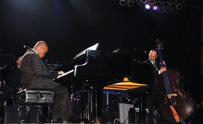 Brandon Boardman (at piano) and his teacher, Billy Johnson, perform at the Long Island Music Hall of Fame Gala on Oct. 23. Mr. Boardman, a Riverhead resident who has Asperger's syndrome, received a standing ovation following the performance. (Credit: Long Island Music Hall of Fame photos)
