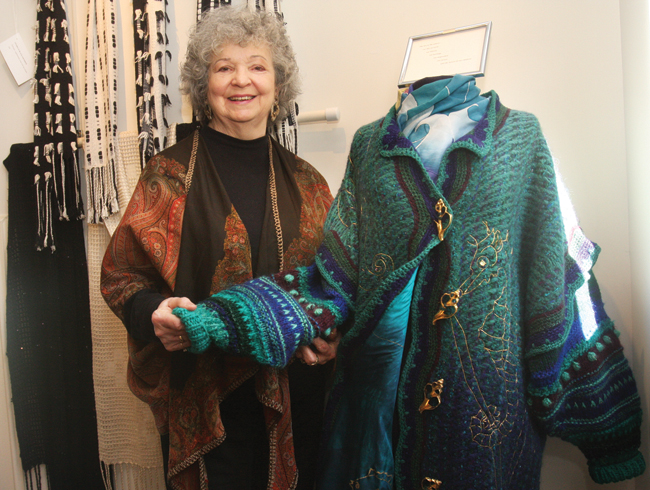 Ms. Ringewald with 'The Octopus's Garden,' an experimental coat that took her months to weave. The coat is part of her 'Weaving My World' exhibit on view through December at Cutchogue New Suffolk Free Library. (Credit: Barbaraellen Koch)