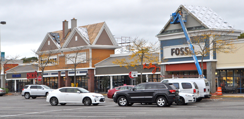 In June, work began to renovate Tanger 2 at Tanger Outlets in Riverhead. The upgrades include new storefront facades and gabled roofs. (Rachel Young photo)