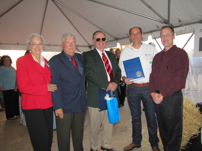 Tebbens Steel at EPCAL celebrated its 70th anniversary Sept. 19. Elsie Tebbens, Councilman John Dunleavy, Tom Tebbens Sr, Tom Tebbens II, and Riverhead Supervisor Sean Walter celebrated the milestone. (Credit: Tim Gannon)