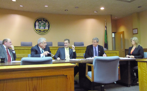 Riverhead councilman John Dunleavy (second from left) argues with Supervisor Sean Walter (middle) during Thursday's work session.