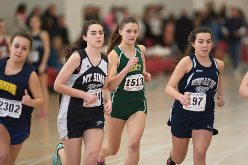 GARRET MEADE PHOTO  |  McGann-Mercy senior Caitlyn Walsh races in the 1,000 with Shoreham freshman Christy Capek.