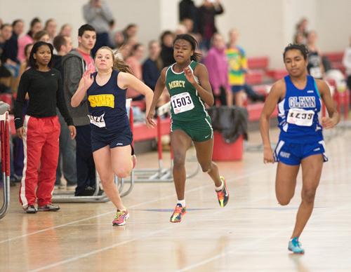 GARRET MEADE PHOTO  |  McGann-Mercy junior Danisha Carter races in the 55-meter dash alongside Shoreham-Wading River freshman Megan Kelly.