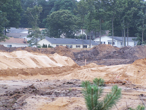 TIM GANNON FILE PHOTO | Excavation at the site of a future Costco on Route 58 stretches up to neighboring homes in Foxwood Village.