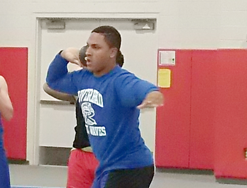Riverhead senior Troy Trent prepares for the shot put in Sunday's League III Championship. (Credit: Joe Werkmeister)