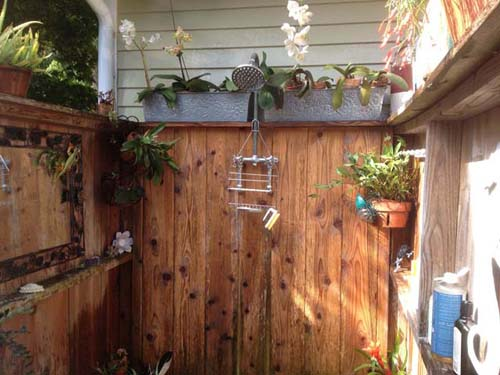 "Kristin Sabat of Mattituck says, ""We used cedar boards and 4x4s to frame it. There's a brick floor that's pitched to a drain in the middle that goes to a drywell. My husband and I use it every day from spring 'till fall unless it's pouring rain."