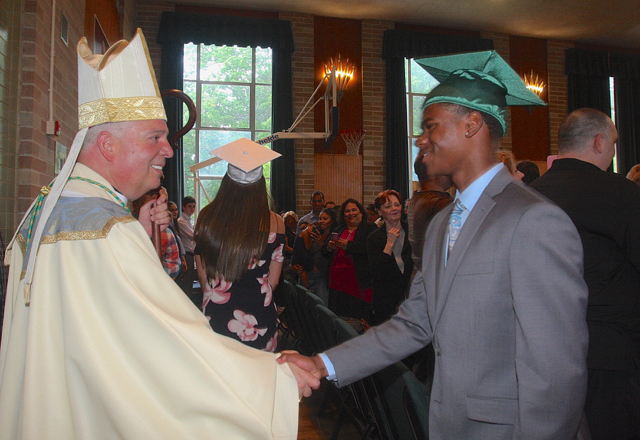 Auxiliary Bishop Nelson Perez congratulated the seniors after the Graduation Liturgy. (Credit: Barbaraellen Koch)
