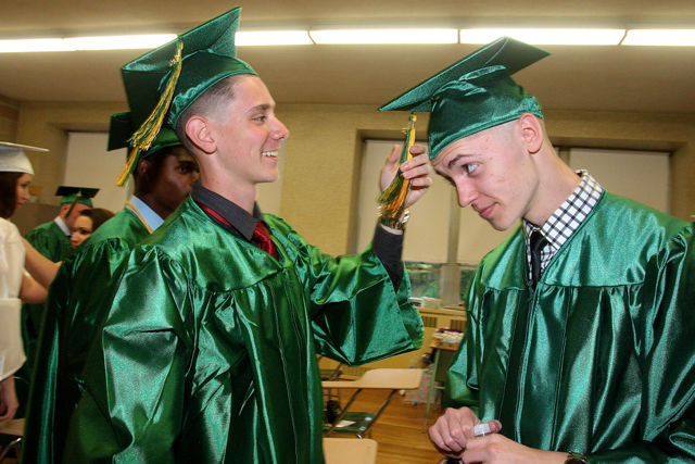 Jules Guasp of Ridge (left) helps his friend Tyler Hamburger by fixing his tassel. (Credit: Barbaraellen Koch)