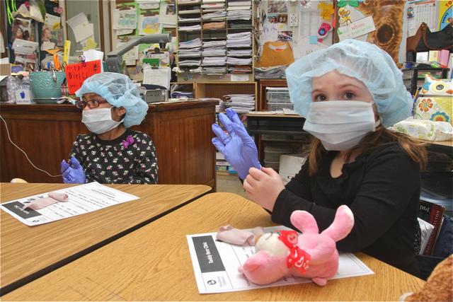 Karisha Mazariegos-Guerrero and Summer Realander work on their teddy bears.