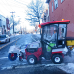 Town worker Scott Sulzer cleans sidewalks downtown Riverhead. (Credit: Barbaraellen Koch)