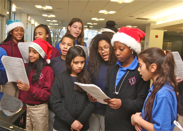 The Riverhead Charter School choir sing in the lobby of Peconic Bay Medical Center Tuesday. (Credit: Barbaraellen Koch)