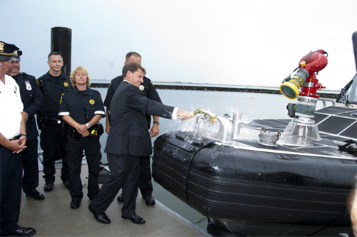 COURTESY PHOTO | Sheriff DeMarco ceremoniously smashes the champagne bottle on the bow of Marine 41.