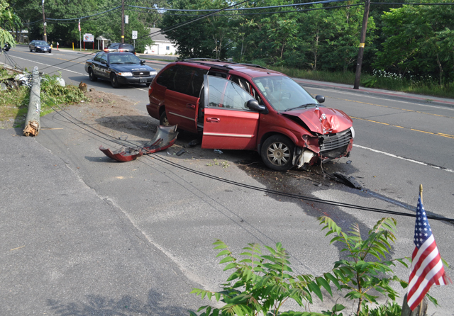 A mini-van carrying six people crashed into a telephone pole on Flanders Road Sunday afternoon. (Credit: Grant Parpan)