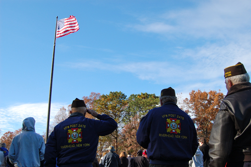 JOSEPH PINCIARO PHOTO | A member of the Riverhead VFW salutes the flag on Veterans Day 2013.