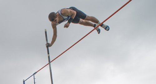 Charles Villa soars over the bar in the pole vault Friday. (Credit: Robert O'Rourk)
