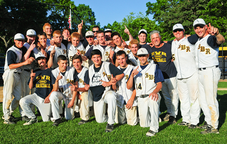 BILL LANDON PHOTO | The Shoreham-Wading River baseball team won a wild extra inning game against Sayville for its first county title since 2002.