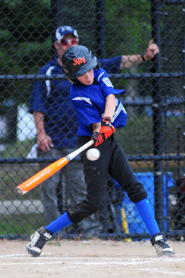 Connor Saville lines a base hit through the infield. (Credit: Bill Landon)