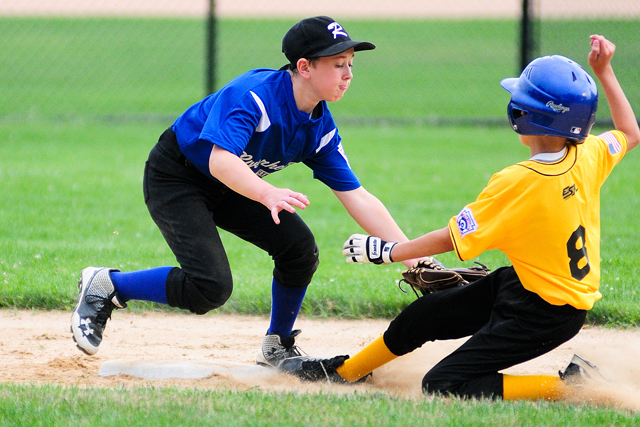 Mike Mowdy applies the tag at second base Thursday against Eastport. (Credit: Bill Landon)