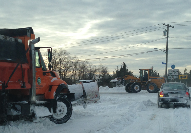 Highway crews clear snow near Hulse Landing Road and Route 25A in Wading River Wednesday morning. (Credit: Joe Werkmeister)