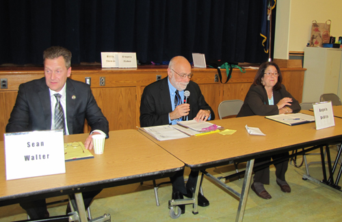TIM GANNON PHOTO | Riverhead Town Supervisor Sean Walter, left and challenger Angela DeVito with moderator Sid Bail.