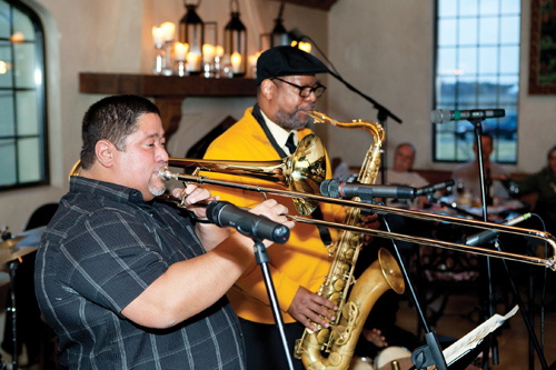 KATHARINE SCHROEDER FILE PHOTO  |  Papo Vazquez, left, with Willie Williams on saxophone at Raphael Vineyards during last year's Winterfest.