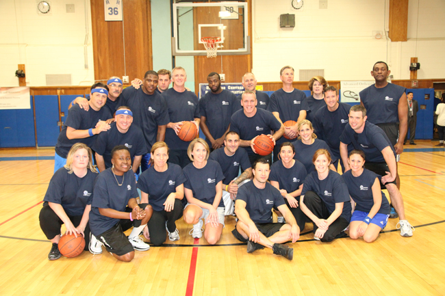 The Harlem Wizards pose with Riverhead faculty members at last year's game. (Credit: Riverhead School District)