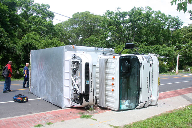 The truck that flipped over on Flanders Road Monday. (Credit: Barbaraellen Koch)