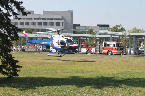 PAUL SQUIRE PHOTO | A Suffolk County helicopter lands near the county center in Riverside Tuesday afternoon.