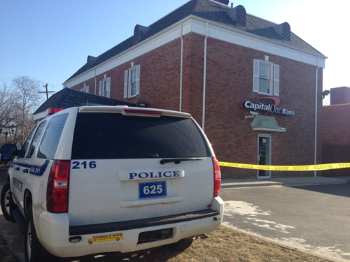 A Riverhead Police car at the East Main Street Capital One bank. (Credit: Paul Squire)