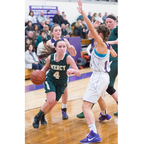 Mia Behrens drives to the basket Friday against Port Jefferson. (Credit: Robert O'Rourk)