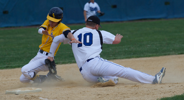 Shoreham-Wading River pinch runner Alex Bettenhauser is tagged out at third in Friday's semifinal loss at John Glenn. (Credit: Robert O'Rourk)