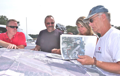 BARBARAELLEN KOCH PHOTO | Town officials including Councilwoman Jodi Giglio review bike path plans with former councilman George Bartunek, who initiated the plan to encircle EPCAL with a bike path.