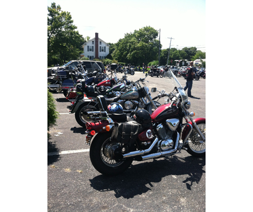 MICHAEL WHITE PHOTO | Motorcycles lined up in front of the Elks Lodge in Riverhead.