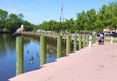 BARBARAELLEN KOCH FILE PHOTO | The Peconic River boardwalk that runs along the East Main Street parking lot.