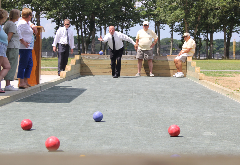 Town Board Member James Wooten giving it his best shot on the bocce court Tuesday. (Credit: Carrie Miller)