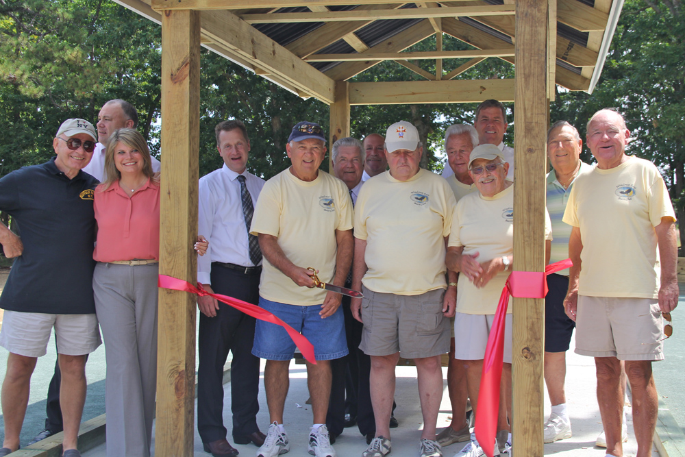 Town board members joined the Windcrest East Bocce Team for a ribbon cutting ceremony Tuesday morning.