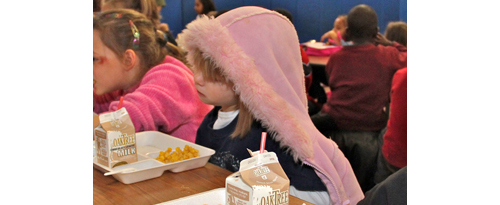 Elementary school students enjoying lunch. (Credit: Times/Review stock art)