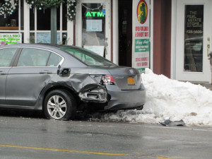 TIM GANNON PHOTO | This car was struck in Hampton Bays after a fatal car crash early Sunday morning.