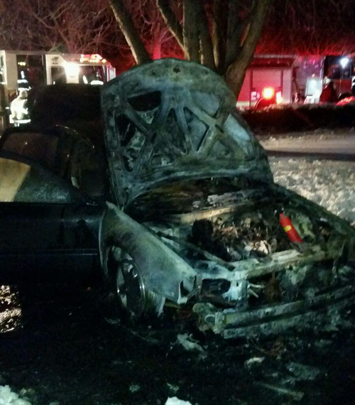 A late model Chevy was consumed by fire Saturday night in Jamesport. (Credit: Jamesport Fire Department)