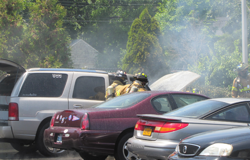Riverhead firefighters put out a car fire Thursday afternoon. (Credit: Tim Gannon)
