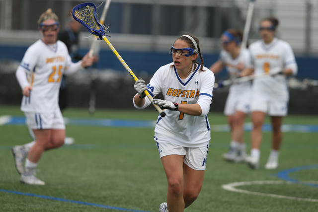 Riverhead graduate Carolyn Carrera finds herself in a new role on the lacrosse field as a player on Hofstra's team. (Credit: Zack Lane/Hofstra University)