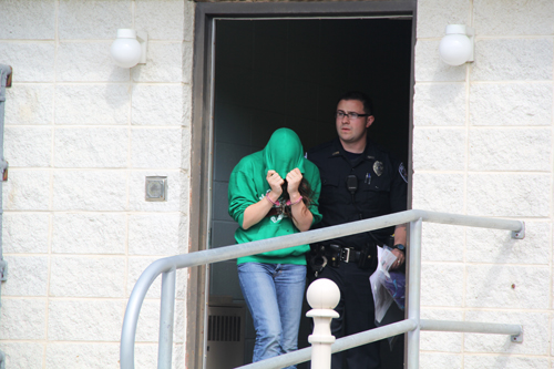 Jacqueline Celentano, 21, of Calverton is led out of Southampton Police Department headquarters in Hampton Bays Wednesday morning for a Justice Court appearance. (Credit: Carrie Miller file)